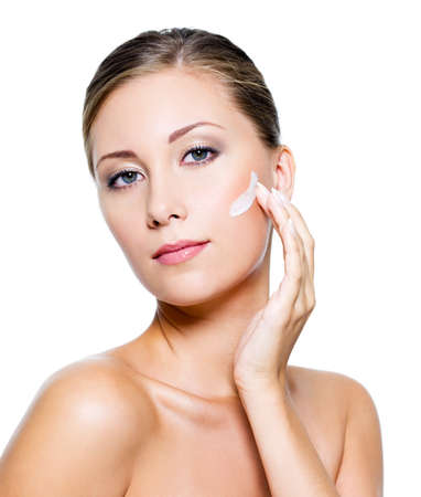 Beautiful woman with clean skin applying cosmetic cream on face Stock Photo - 7817286