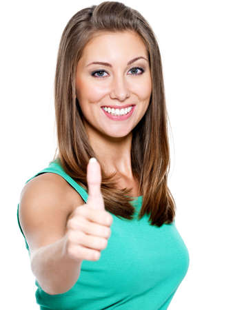 thumbs up gesture: Portrait of attractive young woman showing a thumbs up on white background
