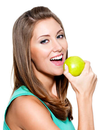 apple bite: Young happy smiling woman with green apple - isolated on white