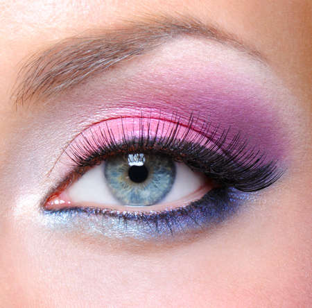 multicolored eye macro: Eye make-up with bright saturetad colors - macro shot Stock Photo