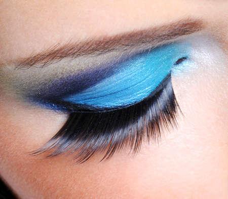 saturated: Fashion saturated make-up with long false eyelashes
