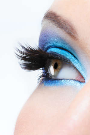 profile view: Profile view of a female eye with bright blue  make-up and long black false eyelashes Stock Photo