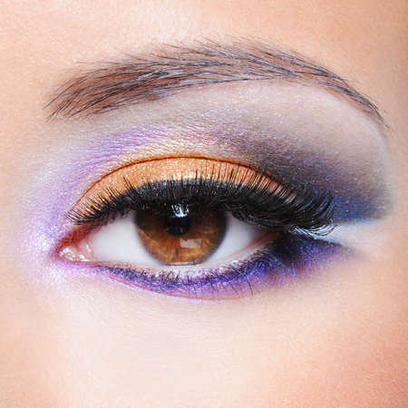 saturated: Macro shot of a female eye with fashion saturated make-up