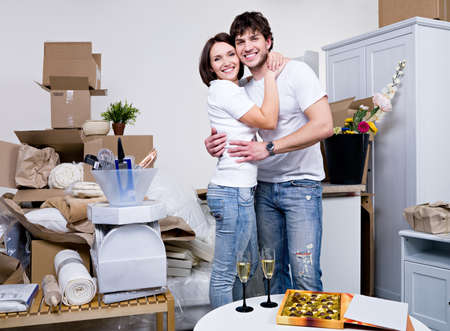 couple home: Happy beautiful couple embracing in their new flat