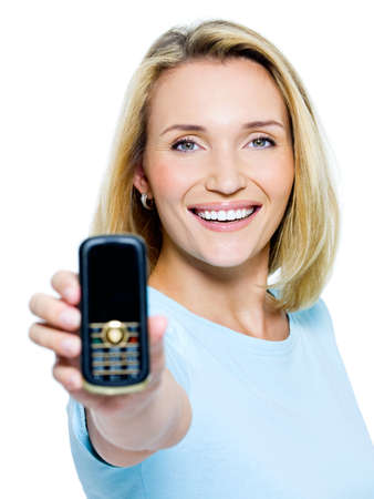 Happy woman showing mobile phone isolated on white  photo