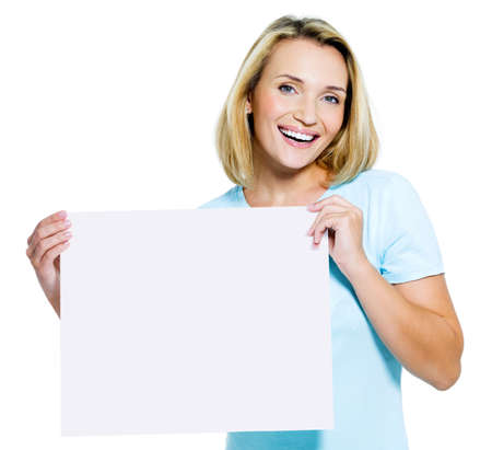 beautiful happy woman holds the white  blank card  - isolated  photo