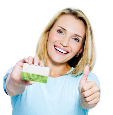 happy woman showing thumbs-up with credit card on white bacground photo