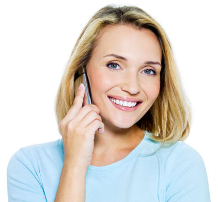 Happy woman speaks on the phone - isolated on white photo