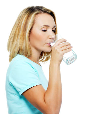 pleasures: The young woman drinks water on a white background