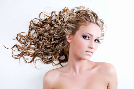 bared: Beautiful young woman with long curly hair