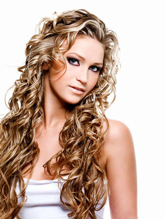 Beautiful woman with luxury blond long curly hair photo