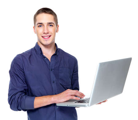 demonstrate: Happy young man with laptop - isolated on white Stock Photo