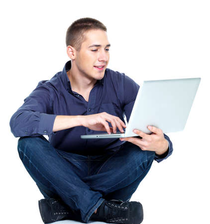 notebook computer: Happy young man with laptop - isolated on white Stock Photo