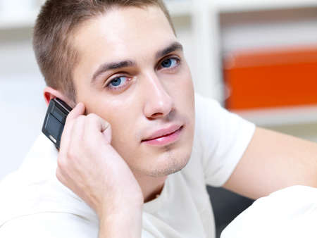 thoughtful man call in the phone on white background photo