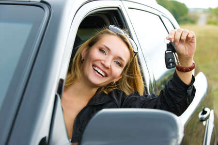 Beautiful young successful  woman in the new car with keys - outdoors Stock Photo - 8038883