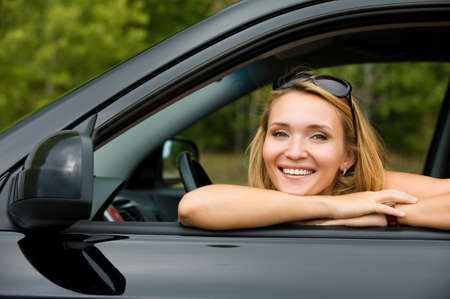 portrait of beautiful young cheerful woman in the new car  - outdoors Stock Photo - 8038882