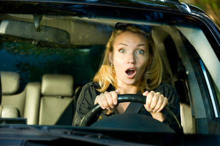 fear of failure: Fright face of  woman driving car and strongly squeeze the wheel