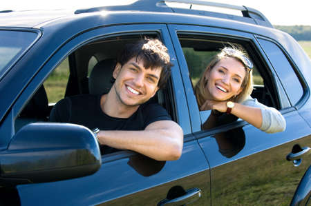 female driver: bautiful happy young couple driving the car Stock Photo