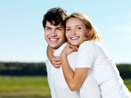 portrait of young happy beautiful couple on nature Stock Photo - 8040916