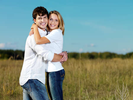 lovers park: portrait of young happy beautiful couple on nature