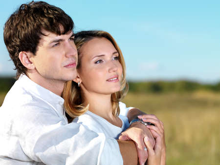 portrait of young happy beautiful couple on nature   photo
