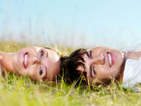portrait of young happy beautiful couple on nature Stock Photo - 8040919