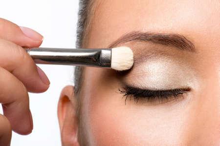 woman applying eyeshadow on eyelid using makeup brush Stock Photo - 8040942