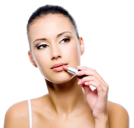 applying lipstick: beauty woman applying lipstick on lips - isolated Stock Photo