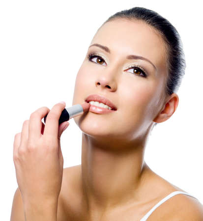 apply: beauty woman applying lipstick on lips - isolated Stock Photo