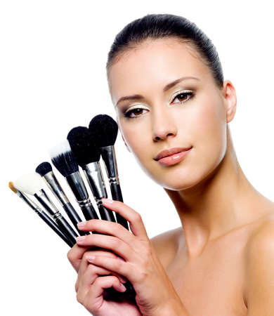 Beautiful woman with makeup brushes near her face - isolated on white Stock Photo - 8040956