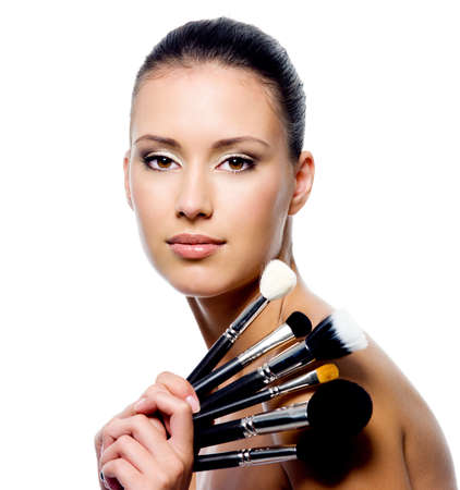 Portrait of beautiful woman with makeup brushes - isolated on white Stock Photo - 8040935