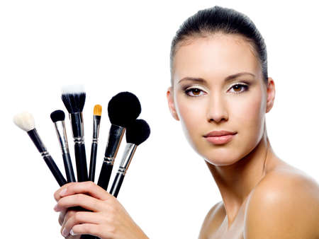 makeup brush: Portrait of beautiful woman with makeup brushes - isolated on white