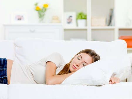 beautiful young woman sleeps on a bed in a bedroom at home Stock Photo