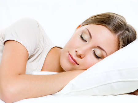 beautiful young woman sleeps on the sofa at home Stock Photo - 8040976