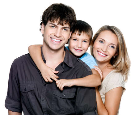 Happy young family with pretty child posing on white background photo