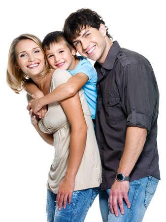 happy families: Familia feliz con ni�o posando sobre fondo blanco  Foto de archivo