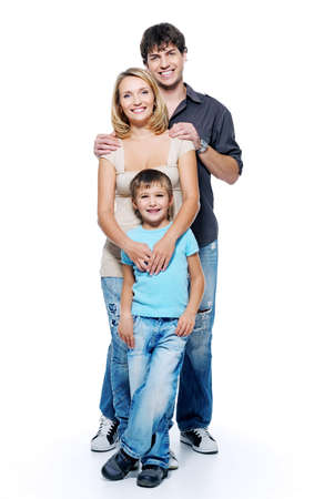 boy standing: Happy family with child posing on white background