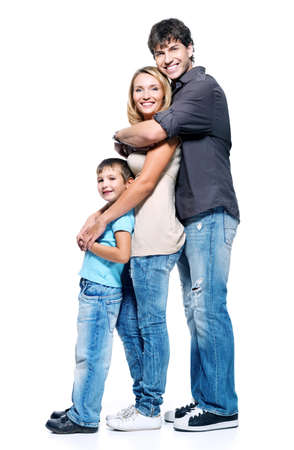 full length portrait: Profile portrait of happy family with child posing on white background Stock Photo