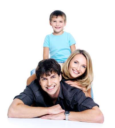 young happy family with child posing on white background photo