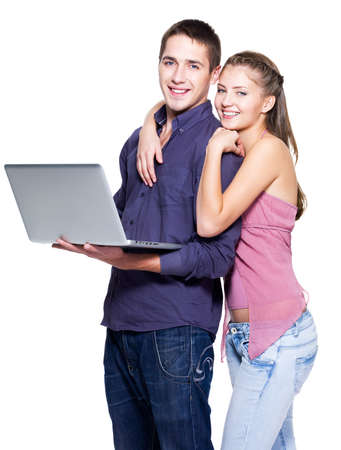 Happy young couple with laptop on white background Stock Photo - 8041244