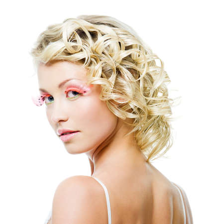 profile portrait of beautiful blond woman with fashion makeup and curly hairs photo