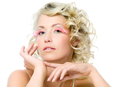 Glamour makeup on the face of beautiful woman. Curly hairstyle photo