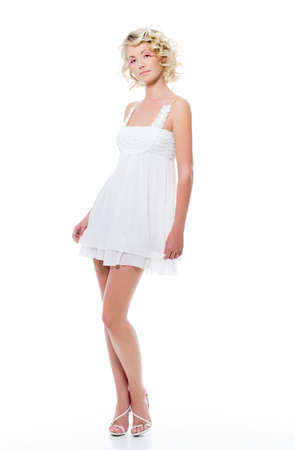 Fashion sexy beautiful woman with modern white dress posing in studio photo
