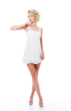 Fashion sensuality attractive woman with modern white dress posing in studio photo