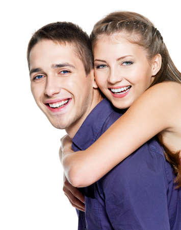 Beautiful young happy couple on white background Stock Photo - 8041252