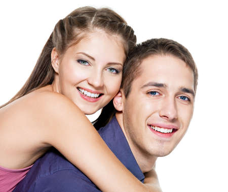 Beautiful young happy couple on white background photo