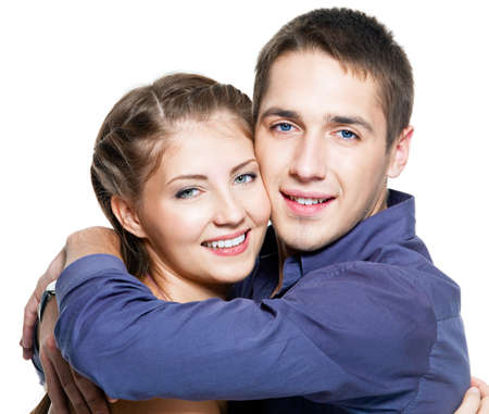 Portrait of embracing young happy beautiful couple - white background photo