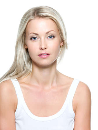 Face of  beautiful woman with clean skin on a white background photo