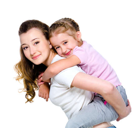 Little cheerful girl on a back of her young beautiful mother - isolated on white photo