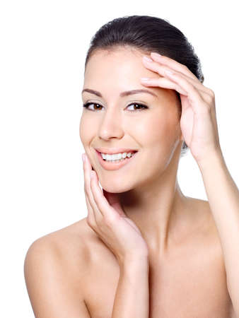 Happy smiling woman's face with healthy clean skin - isolated on white Stock Photo - 8078578
